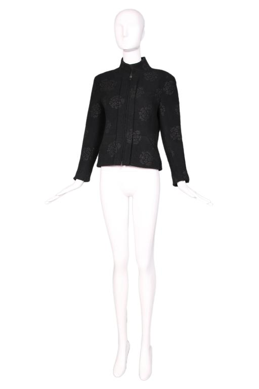 Chanel black wool boucle zipper front jacket with stand collar and sparkly camellia flower print most likely made out of raffia. Lined entirely in camellia print silk. In excellent condition. Size EU 40. 