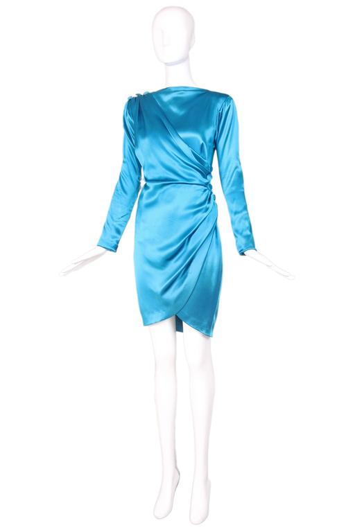 1987 A/H Yves Saint Laurent haute couture runway sample silk cocktail dress in electric blue with oversize buttons and hidden zippers. Dress is in very good condition with some extremely faint discoloration to the fabric at the back of one arm.