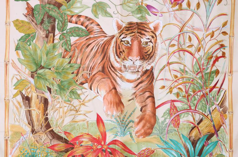 1970's Gucci silk scarf w/ a tiger in the jungle framed by a bamboo border. Gucci logo in upper left and lower right corner. In excellent condition.  MEASUREMENTS: 34