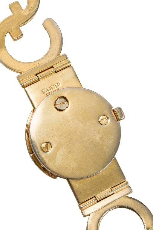 Beige 1970's Gucci Goldtone GG Logo Metal Linked Belt For Sale