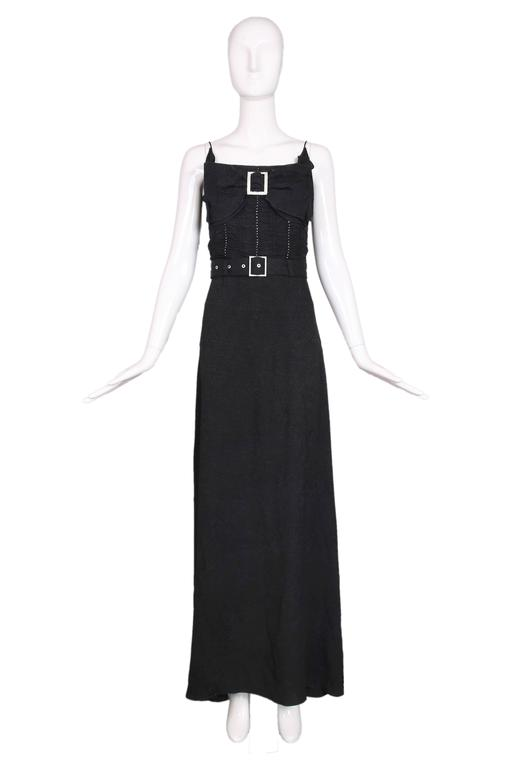 John Galliano black rayon puckered crepe evening dress w/frontal decorative bow at the chest and rhinestone detail that goes down the bodice. Rhinestone buckle detail at bow and waist belt. Fully lined in silk. In excellent condition. Size US