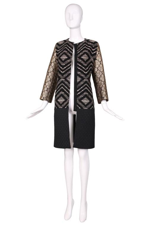 Giambattista Valli black & gold diamond pattern brocade and wool coat w/bottom half in black diamond pattern quilted fabric. Snap closure up center front. In excellent condition.