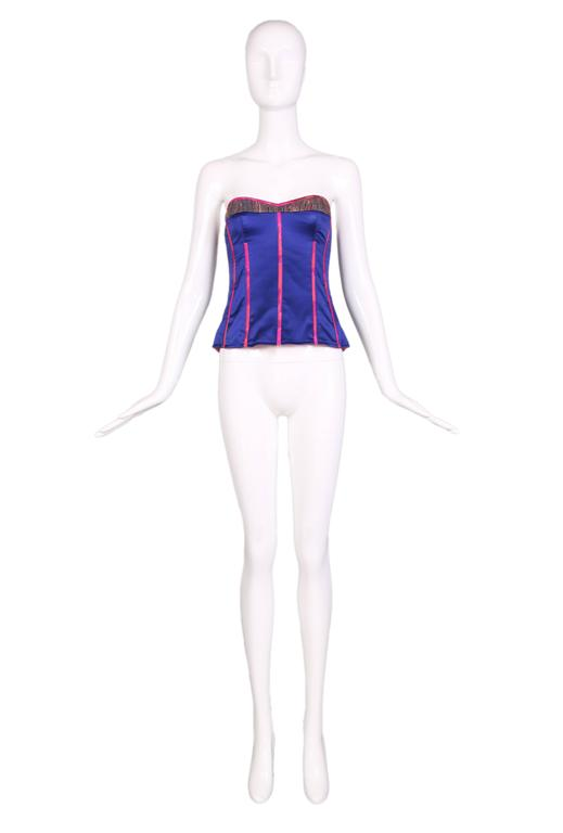 Tracy Feith royal purple silk bustier with hot pink trim and multi-colored lurex ethnic inset detail at top. Back zipper closure. In excellent condition. Size US 1. MEASUREMENTS: Bust - 32