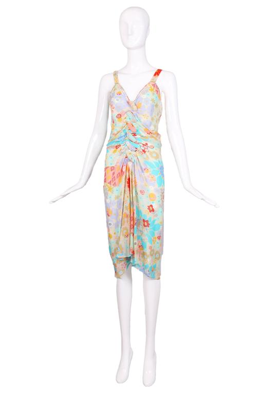 Vintage John Galliano multi-colored floral print bias cut cocktail dress featuring frontal ruching, deep v-neckline, and shoulder straps. Fabric-covered button closures down the back. In excellent condition. Size US 6. MEASUREMENTS (in inches): Bust