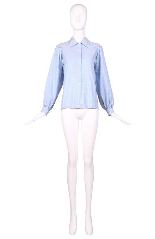 1970's Yves Saint Laurent YSL chambray button down shirt blouse. with oversize sleeves. In excellent condition. Size EU 40.  MEASUREMENTS (in inches): Bust - 36 Waist - 36 Length - 24