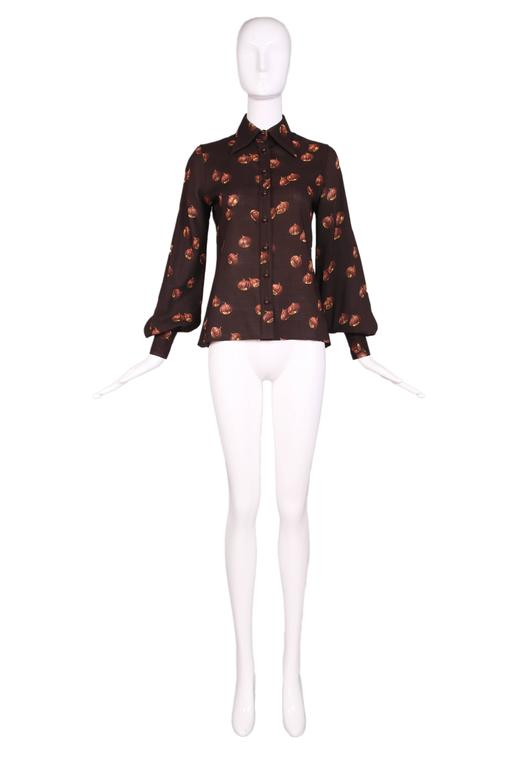 1970's Valentino brown summer wool collared blouse featuring iconic acorn print with and balloon sleeves and fitted cuffs. In excellent condition.  MEASUREMENTS: Bust - 35 Waist - 32 Shoulder - 14 Sleeve - 26 Length - 24