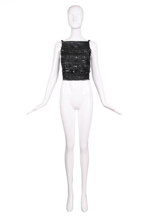 Gianfranco Ferre black open-back crop top embellished in rows with silk ribbon, raffia, and shiny synthetic cord in addition to over-sized geometric faceted beads. Shoulder straps and three straps across the back are elastic and fastened by means of