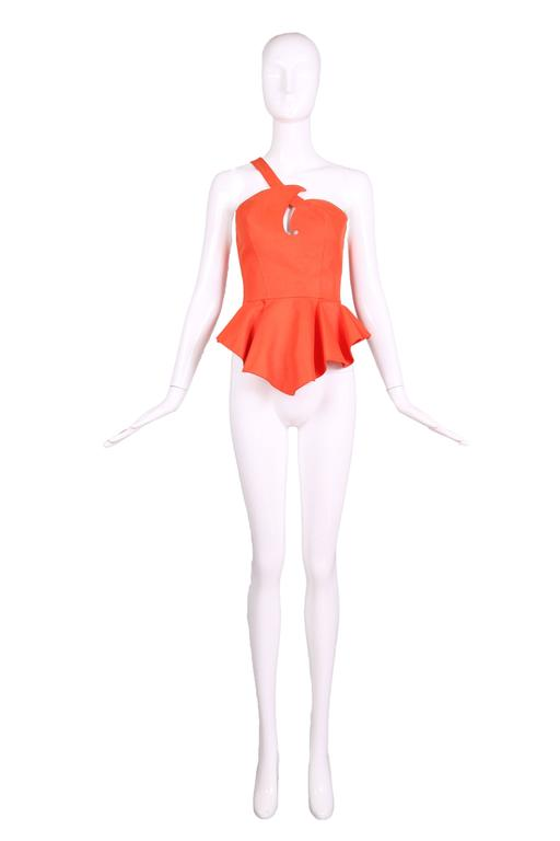 Vintage Thierry Mugler orange single strap, structured sleeveless bustier top with peplum waist and orange snap closures at the back. There is no fabric tag but the fabric feels like a heavy cotton. Size 38 - see measurements. In excellent