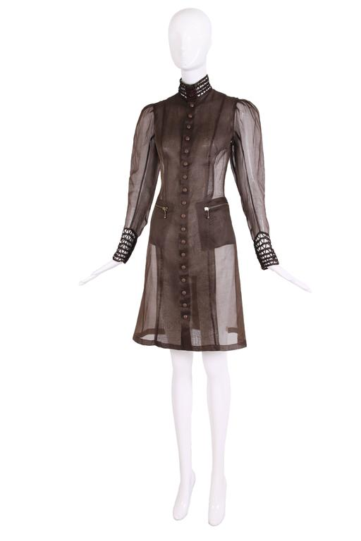 """Jean Paul Gaultier sheer brown silk gazar Victorian-inspired  coat. This coat has a high lace collar with large hook and eye closures and matching lace 5.5"""" cuffs with zipper closures. There are 18 covered snaps at center front and small"""