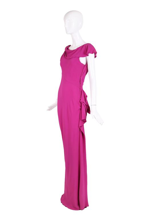 Christian Dior by John Galliano unlabeled bias-cut pink crepe evening gown with signature fabric button closure down the side, asymmetric neckline and decorative ruffle that begins at left hip and continues down side of the skirt. In excellent