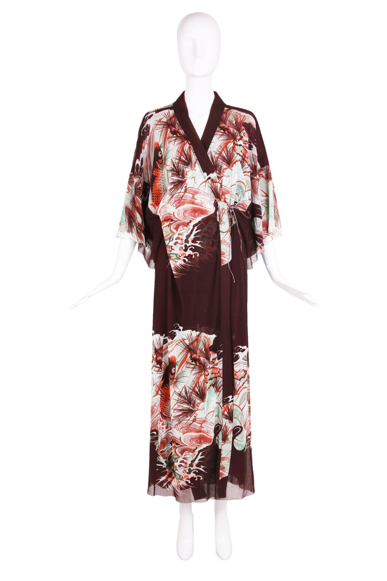 "Jean Paul Gaultier ""Soleil"" label double layered stretch mesh kimono comprised of two layers - the brown outer layer features a Japanese inspired fish print in pale green and orange and the bottom is maroon. The kimono features 3/4 length sleeves"