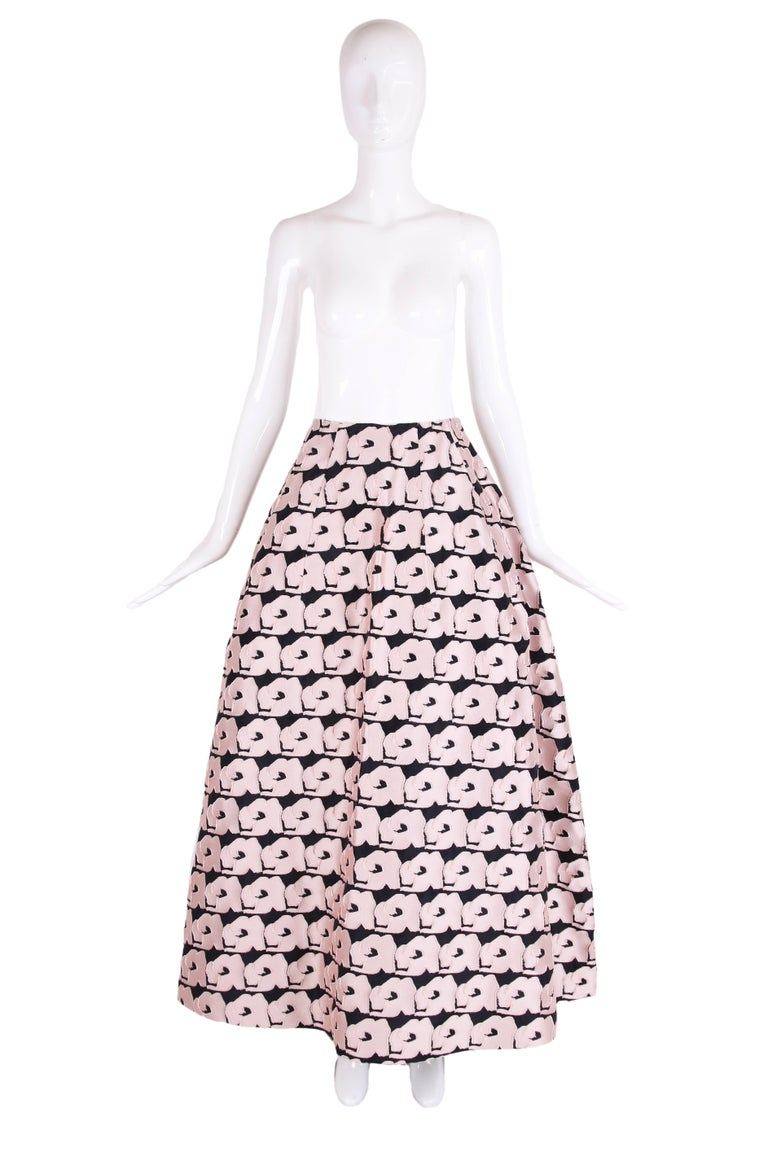2013 Christian Dior blush pink floral ball skirt set on a black background. It is lined in silk with tulle to give its shape, there is a side zipper closure with hook and eye. Size tag 8. In excellent condition - only worn once by original owner for