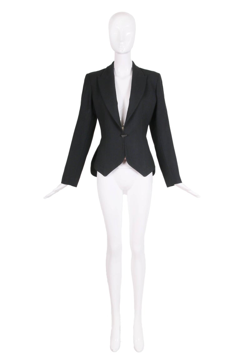"""1991 Azzedine Alaia black wool """"smoking"""" style jacket with a single metal closure at cinched waist and two pointed panels at frontal jacket hem. The same jacket is part of the FIT museum's permanent collection - see listing photos. Size 38"""