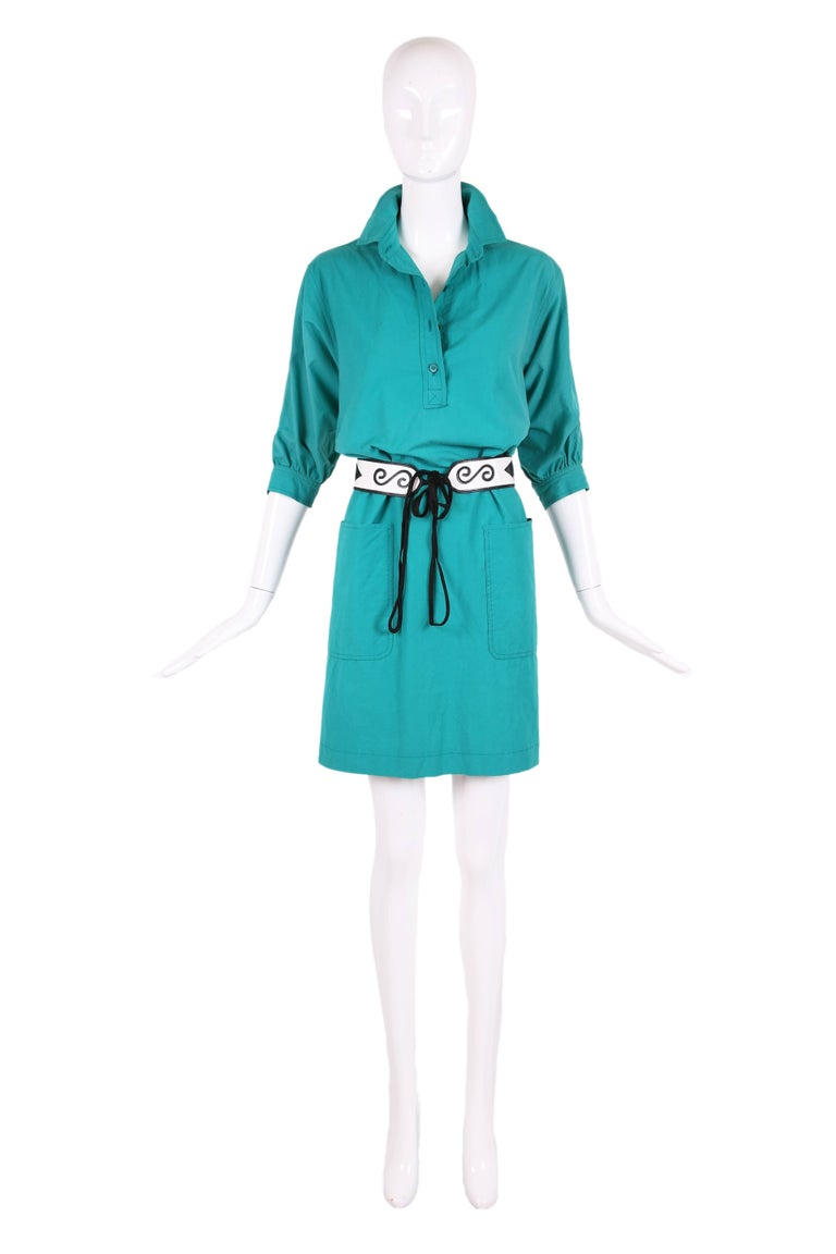 "1970's Yves Saint Laurent teal green smock dress featuring frontal pockets, a subtle slit at either side and 3/4 sleeves. Belt is not included. Size tag 36. In excellent condition. MEASUREMENTS: Shoulder - 16.5"" Sleeves - 15"" Bust -"