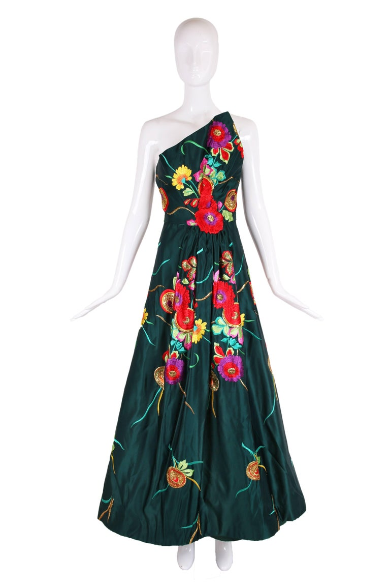 """Arnold Scaasi couture green satin strapless evening gown w/silk and gold metallic embroidered flowers. In excellent condition. No size tag - please consult measurements. MEASUREMENTS: Bust - 36"""" Waist - 26"""" Hips - 39"""" Length - 49"""" (from top of"""