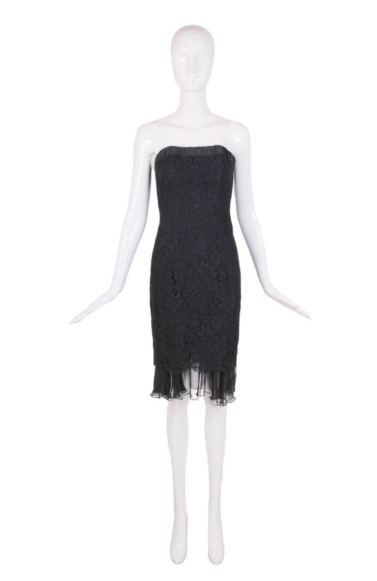 Vintage Chanel black lace strapless cocktail dress with black silk trim and a transparent black chiffon skirt underlay. In excellent condition - size tag 36.