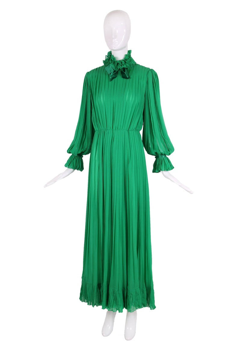 1970's Bill Blass Green kelly green silk chiffon pleated gown with ruffled & silk trim. In very good condition - appears the gown was altered to make waist smaller and is missing the waist belt which was most likely green silk. Disregard the tag