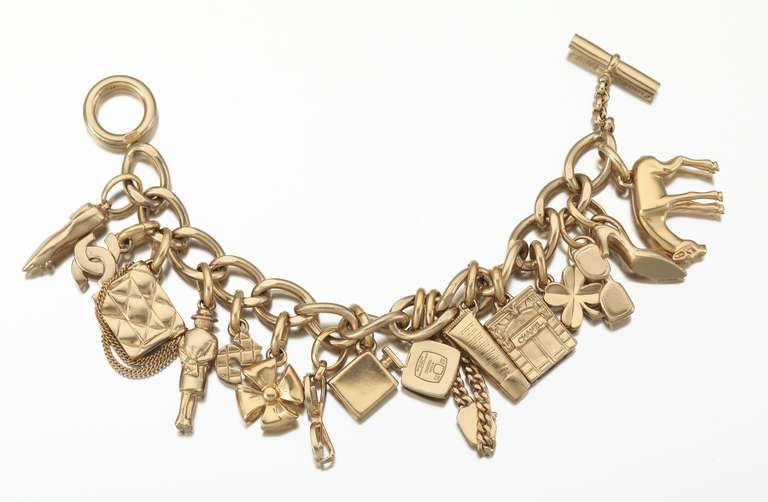 Women's 2002 Chanel Charm Bracelet With 16 Iconic Charms For Sale