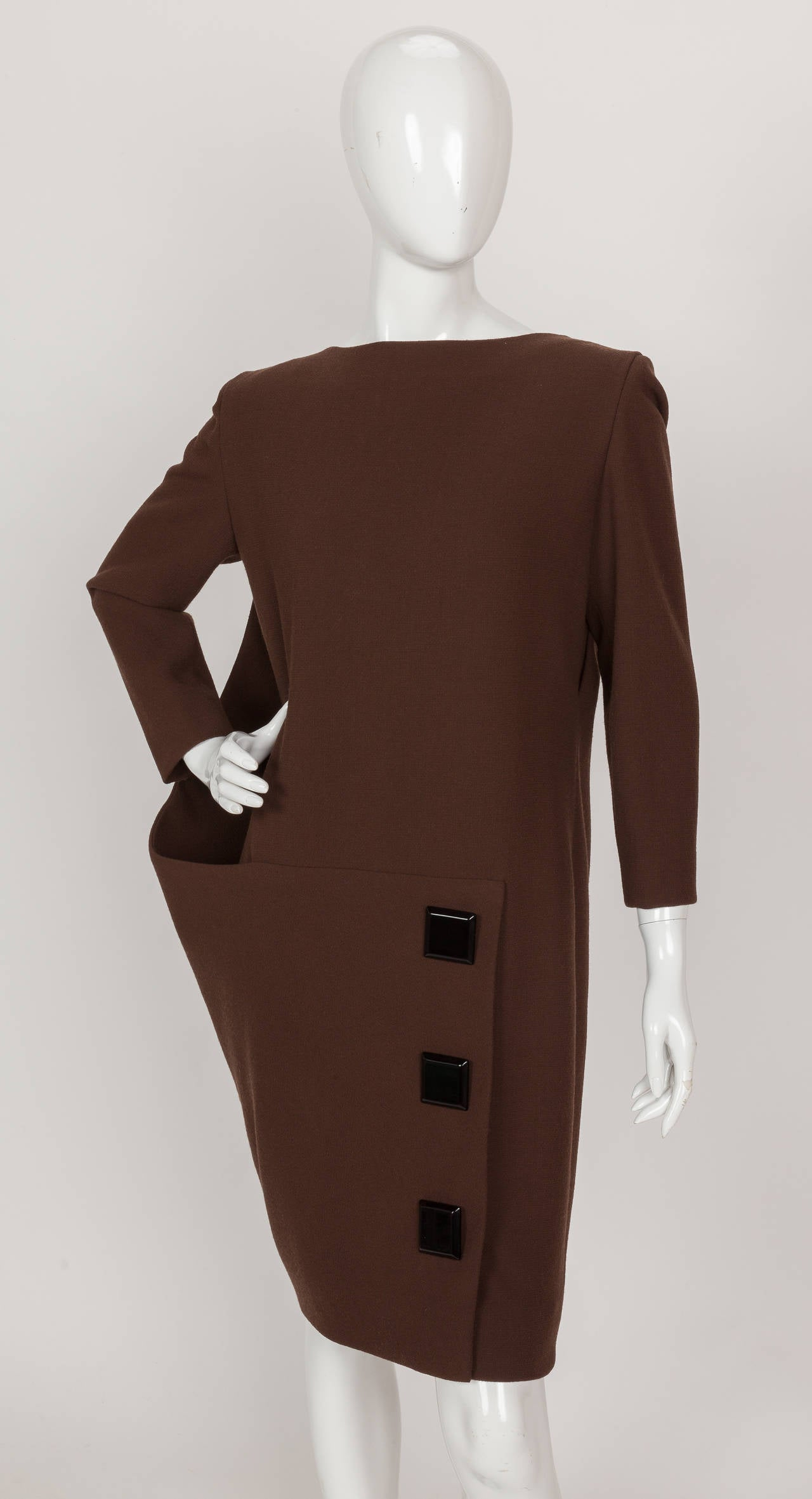 An iconic and rare circa 1992 Pierre Cardin haute couture asymmetric brown cocktail dress with bakelite button trim. What strikes me about this amazing dress is how modern it is - with its asymmetric and triangular silhouette formed out of a