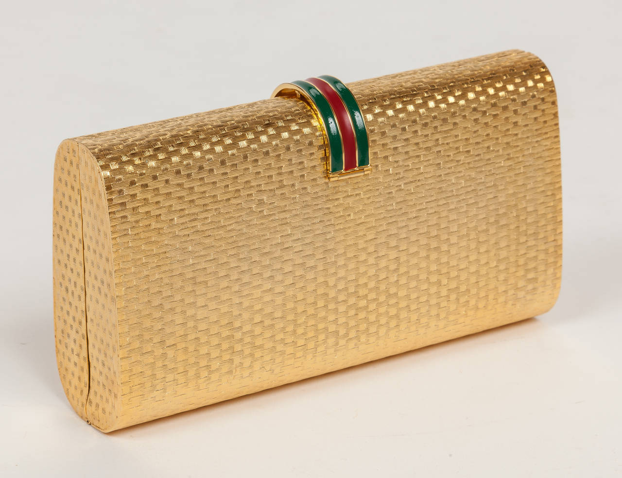 Iconic Gucci Gold Metal Minaudière Clutch w/Enameled Buckle Closure ca.1970s In Excellent Condition For Sale In Los Angeles, CA