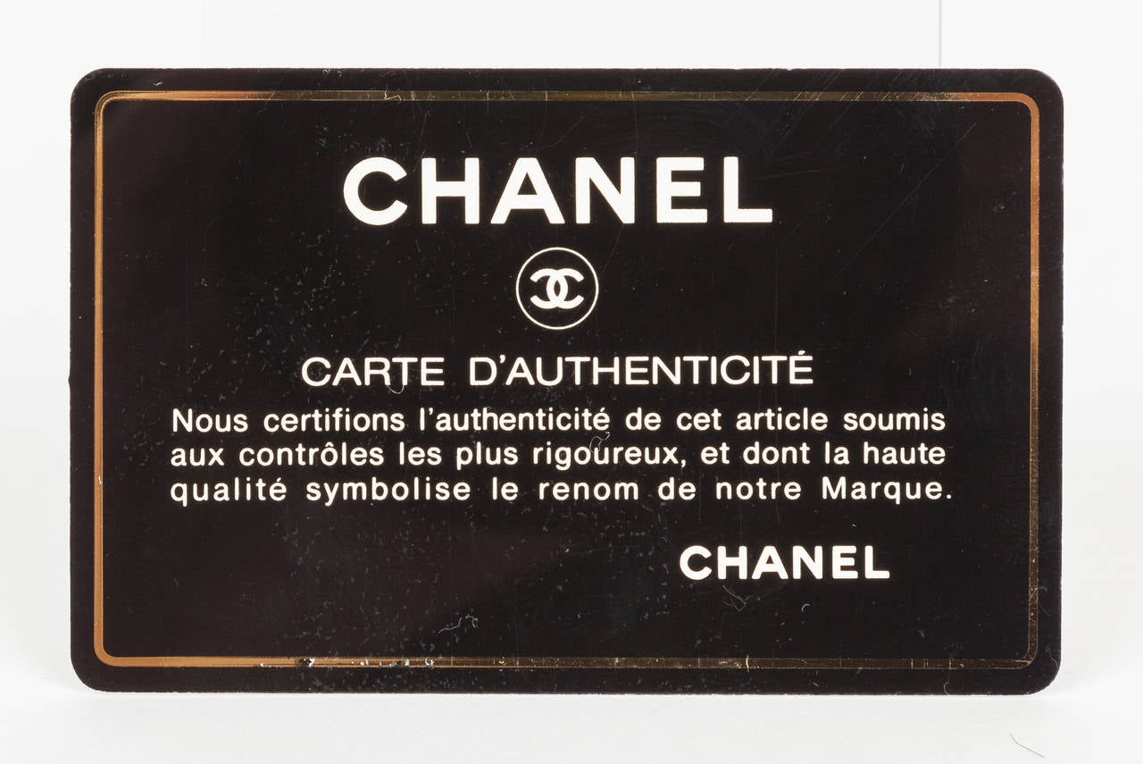 "Iconic Chanel ""Coco"" Logo Pony Hair Leather Handbag Clutch In Excellent Condition For Sale In Los Angeles, CA"