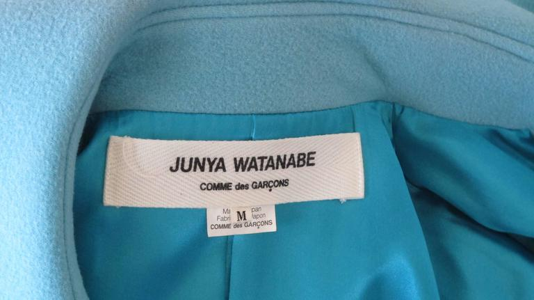 A 2001 powder blue Junya Watanabe for Comme des Garcons melton wool swing coat with oversized Peter Pan collar and oversized white button closures down the front. Fully lined. Size M. In very good condition with some very hard to see color fading of
