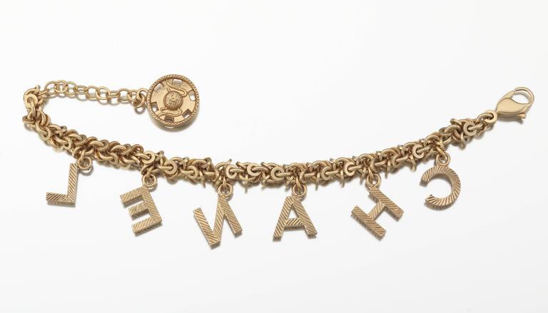 46843729d58b8 2003 Chanel Gold Tone Link Charm Bracelet Spelling