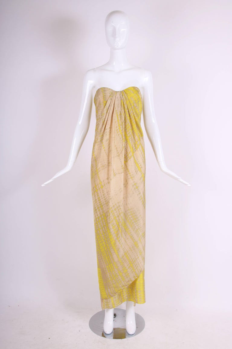 "2003 Alexander McQueen creme with yellow ""batik-like"" printed silk strapless, draped column gown. Bustier at the interior. Size tag 44. In excellent condition. 