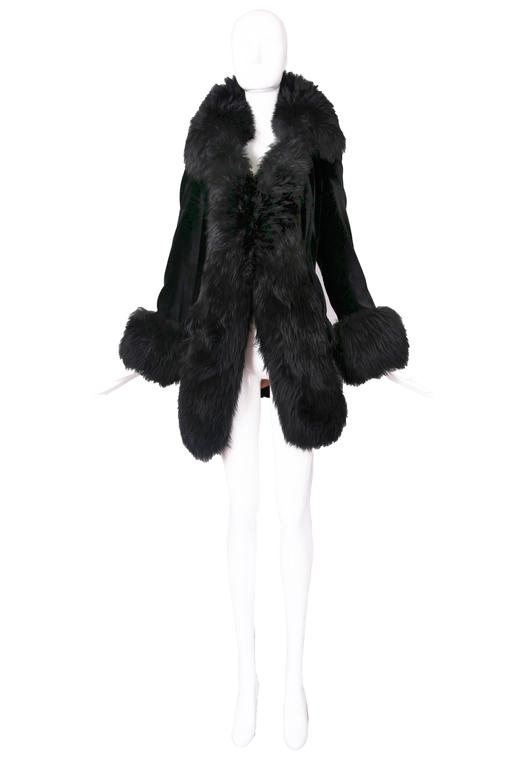1990's Vivienne Westwood dramatic black velvet jacket with oversized faux fur trim at opening, collar, and cuffs. Size 40 MEASUREMENTS: Shoulders - 16