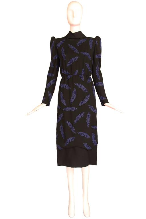1980's Carolina Herrera black wool dress w/blue squiggle print and architectural design elements. Size 6. In excellent condition. MEASUREMENTS: Bust - 36