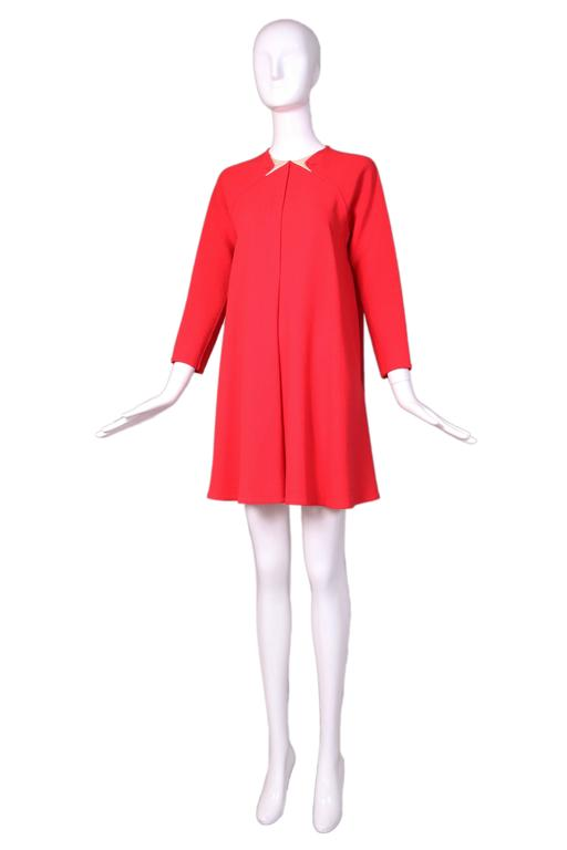 1990's Geoffrey Beene red wool crepe swing dress with signature inlaid geometric collar detail. In excellent condition. No size tag so please consult measurements.