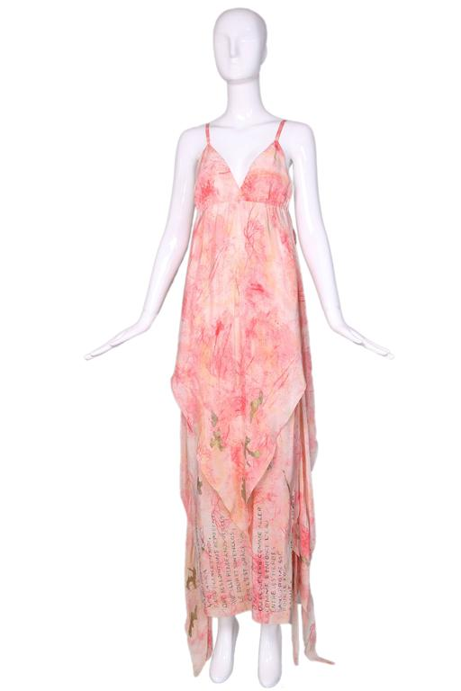 Vintage Chloe orange-pink silk spagetti strap maxi dress w/layers that can be worn multiple ways. Hand-painted gold writing at bottom in French. In excellent condition. Size EU 38. MEASUREMENTS: Bust - 32