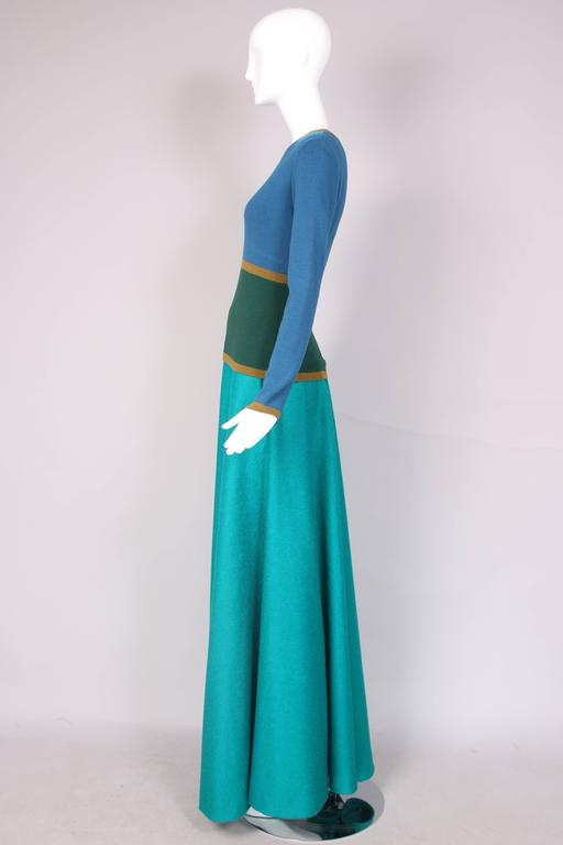 Yves Saint Laurent green & blue long sleeve lambswool sweater and teal blue alpaca wool full maxi skirt ensemble. In excellent condition. Sweater is a size 40, skirt is unlabeled. MEASUREMENTS: Sweater Shoulders - 15