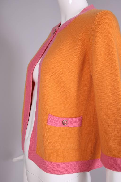 2007 Chanel Orange Cashmere Cardigan W/Chanel CC Logo Buttons & Pink Trim For Sale 2