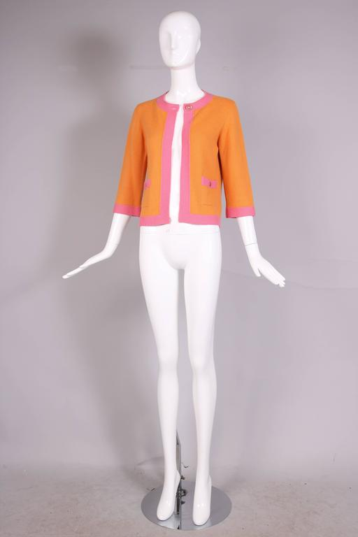 2007 Chanel Orange Cashmere Cardigan W/Chanel CC Logo Buttons & Pink Trim In Excellent Condition For Sale In Los Angeles, CA