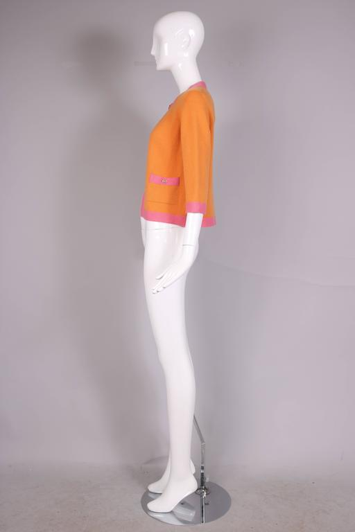2007 Chanel Orange Cashmere Cardigan W/Chanel CC Logo Buttons & Pink Trim For Sale 1