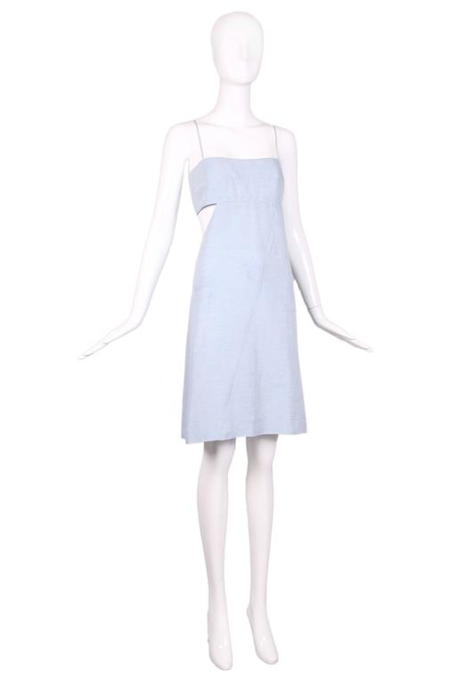 """1990's Claude Montana blue chambray sun dress featuring an asymmetrical cut out at bodice that wraps around to the back and spaghetti straps. In excellent condition. Size US 6. MEASUREMENTS: Bust - 34"""" Waist - 30"""" Hip -"""
