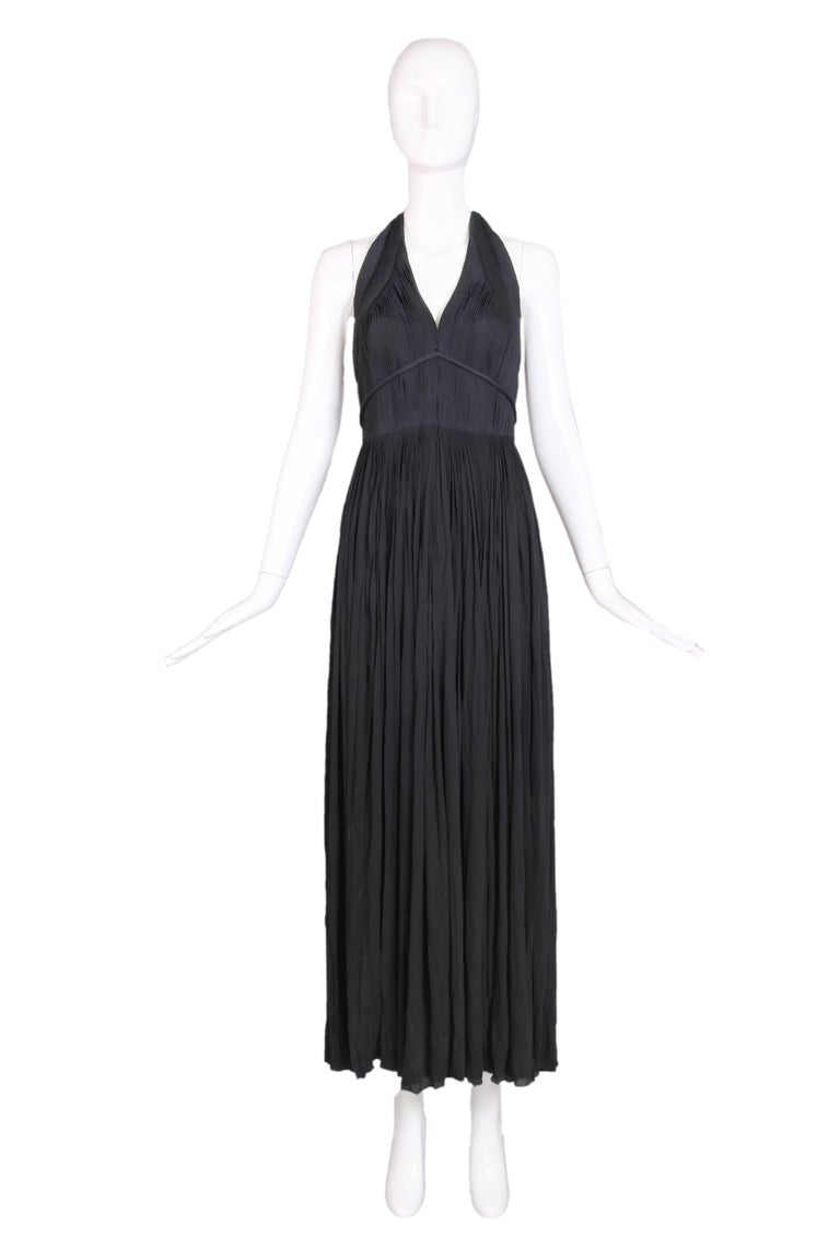 Late 1970's Madame Gres haute couture black silk jersey pleated drapé halter gown featuring a herringbone detail at trim of halter. Dress has a zipper front bodice and a detachable tie that forms a V and ties in the back.  Black silk jersey shawl