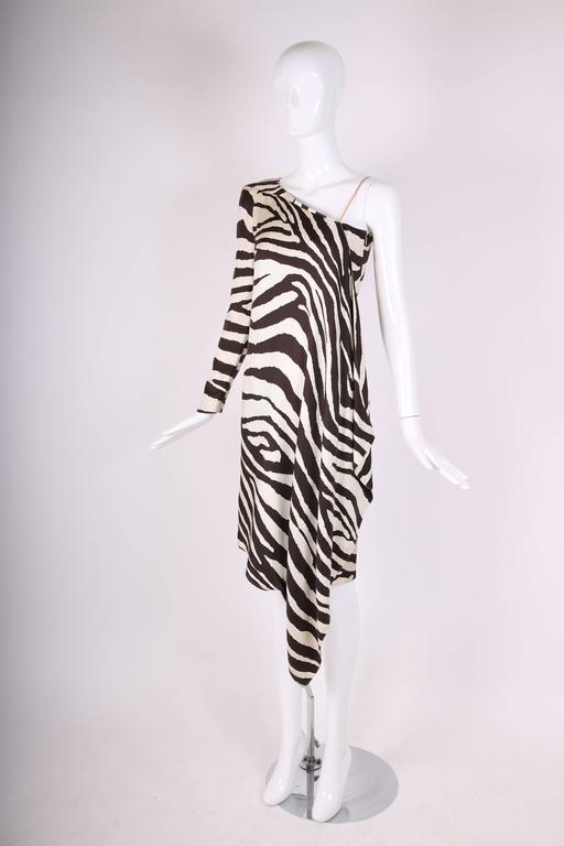 1998 Spring/Summer Thierry Mugler silk twill asymmetrical cocktail dress with iconic Mugler zebra print. This dress has one long sleeve with architectural shoulder and soft draping on the other. There is a side zip closure. Size tag 36. Measurements