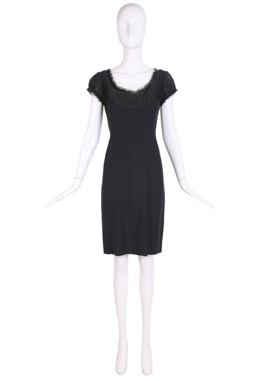 """2010 Alexander McQueen black cocktail dress with ruching and velvet trim at neckline. Size 40. In excellent condition. MEASUREMENTS: Bust - 34"""" Waist - 27"""" Hip - 36"""" Length - 38"""" Shoulder - 14"""" Sleeve - 5.5"""""""