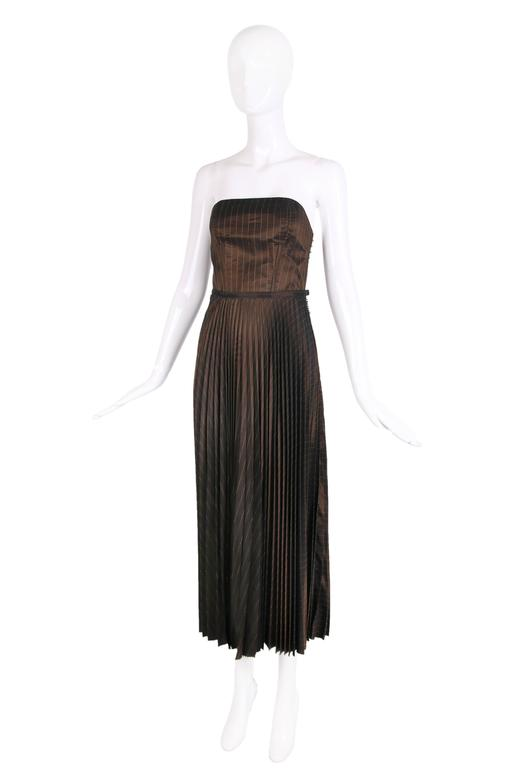 """1990's Jean Paul Gaultier brown striped bustier and pleated skirt ensemble. In excellent condition. Please see measurements.  MEASUREMENTS: Top: Bust - 34"""" Waist - 23"""" Length - 10"""" Skirt: Waist - 28"""" Hip - Free Length - 37"""""""
