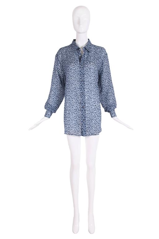 "Hermes men's blue linen collared button down long sleeve shirt featuring small white and blue floral print all over. Single metal ""Hermes Paris"" button at each sleeve cuff. In excellent condition. Size EU 43. MEASUREMENT: Shoulder -"