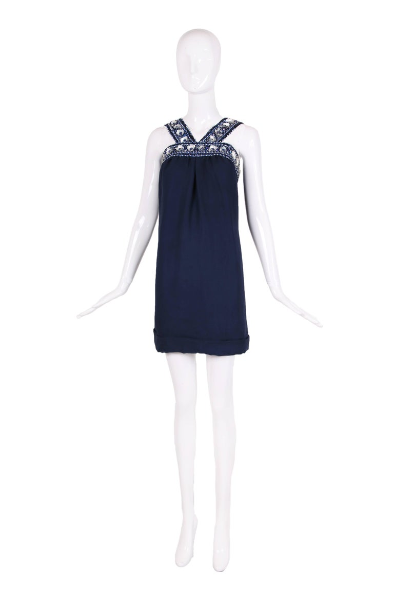 Circa 1966 Pierre Cardin haute couture deep blue double layered silk chiffon cocktail dress with beaded embellishments at the neck and shoulder straps. Zipper closure at center back ending in three hook and eye closures at top. Entirely lined in