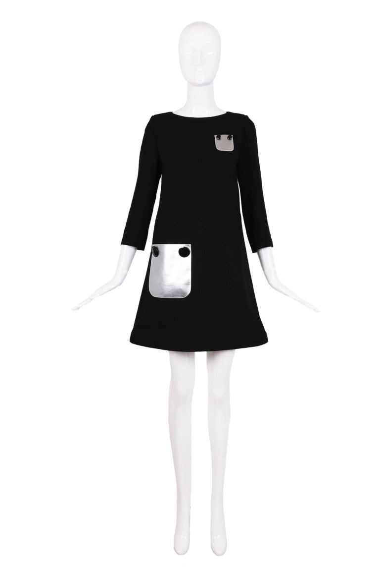 Pierre Cardin haute couture black 3/4 sleeve shift dress with two silver decorative pockets and oversized decorative buttons. Dress is made from a lightweight wool crepe and is in excellent condition. Please see measurements. MEASUREMENTS: Bust: