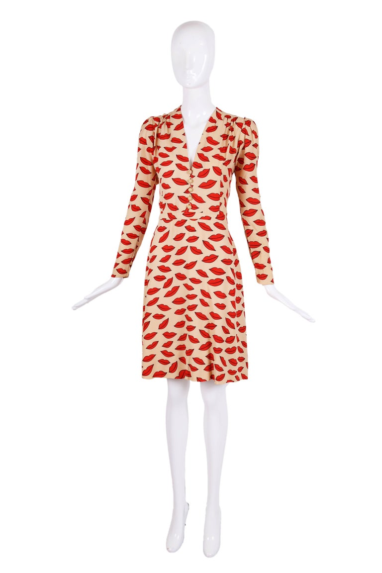 The celebrated 1971 Yves Saint Laurent lips print dress from the collection that was panned when it came out but now universally revered. We are so lucky to be offering this giant of a collector's piece - see original editorial amongst photographs.