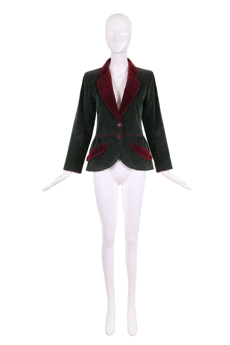 Yves Saint Laurent dark green long sleeve 100% cotton corduroy jacket with burgundy velvet trim and peplum waist. Features two frontal slanted pockets, burgundy button closures at waist and cuff and is fully lined at the interior. In excellent