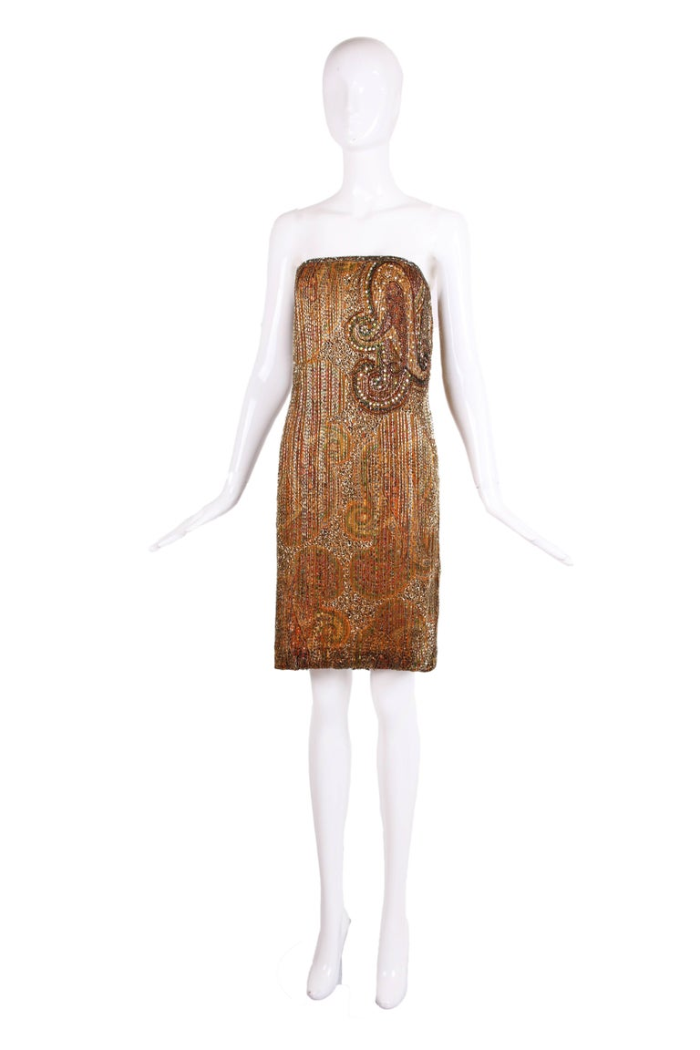 1970's Bob Mackie paisley print beaded & sequined mini dress with matching scarf. It is in excellent condition with some bead loss - this is reflected in the price. Please see measurements.