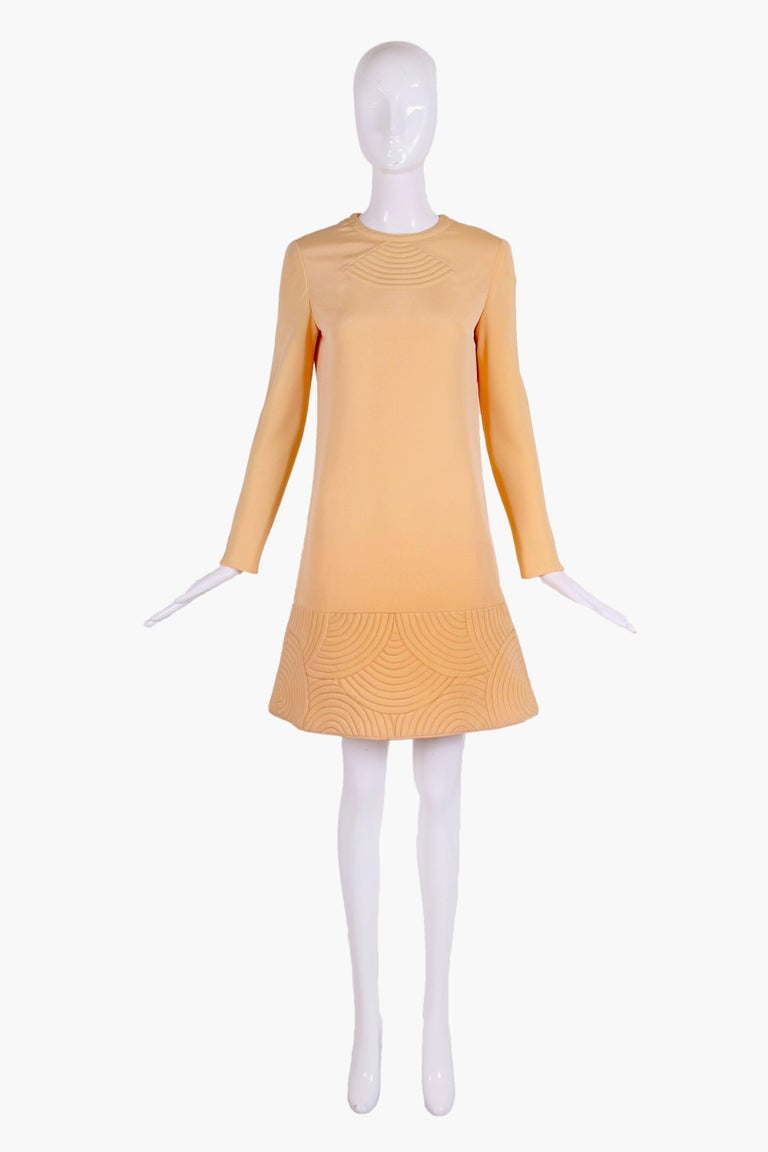 1970's Pierre Cardin silk space age mini dress in a pale peach/sherbert color. Dress has classic Cardin quilted geometric design at hem and center bust. In excellent condition - please see measurements. MEASUREMENTS