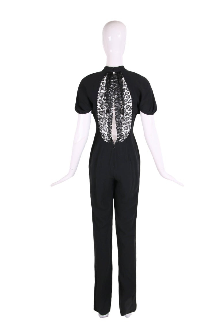2012 Yves Saint Laurent black crepe jumpsuit w/shortsleeves and lace illusion panel at back. IN excellent condition - size 38.