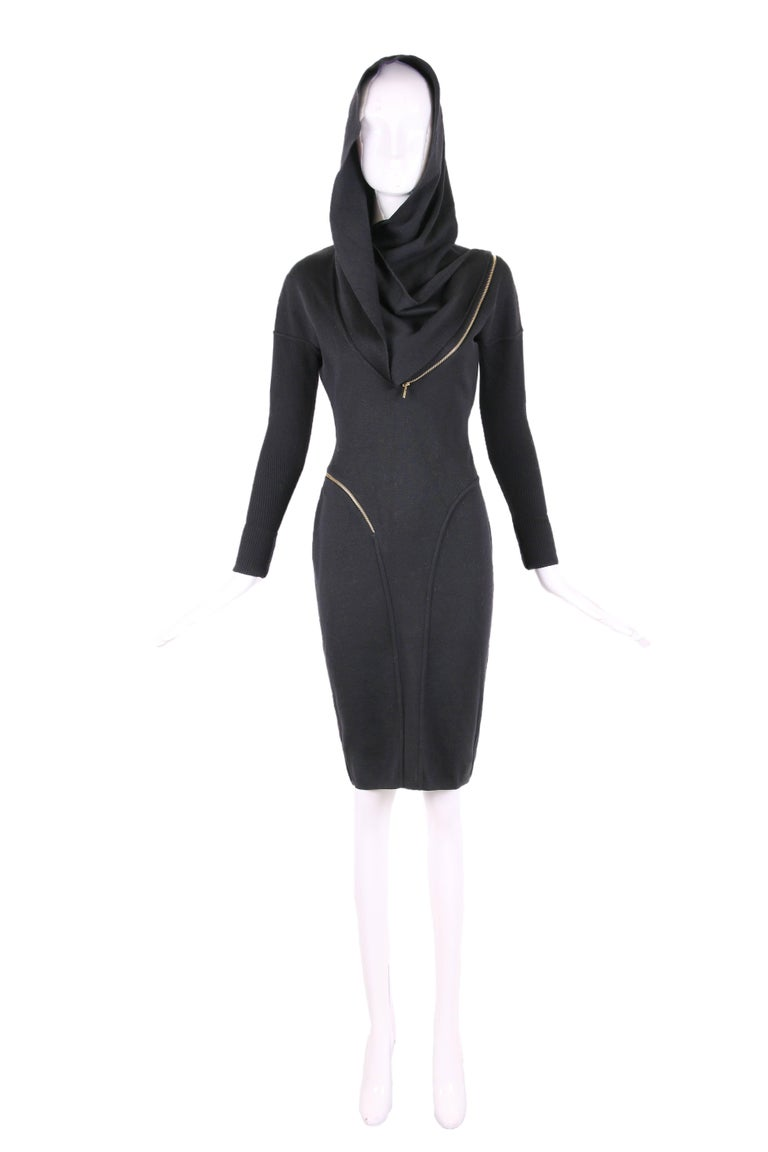 Iconic 1986 Azzedine Alaia black wool stretch hooded dress with zipper design. In excellent condition. Size tag Medium - please see measurements.